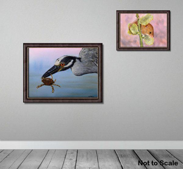 Watercolour painted heron bird, by Paul Hopkinson, framed on a wall