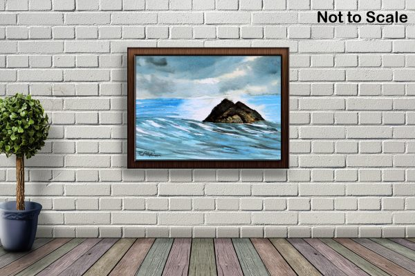 Watercolour painting of the sea by Paul Hopkinson hanging on a brick wall