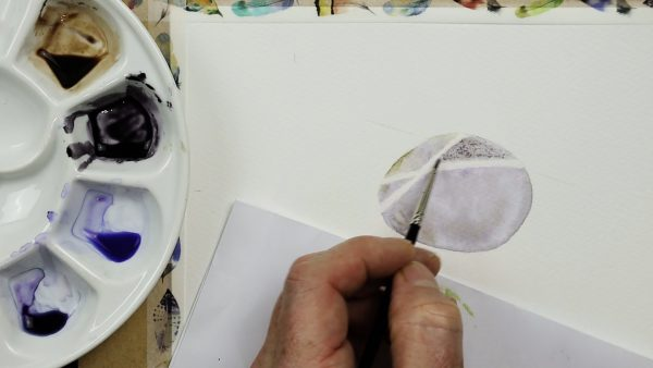 Progress photos of a watercolor stone painting - stage 1