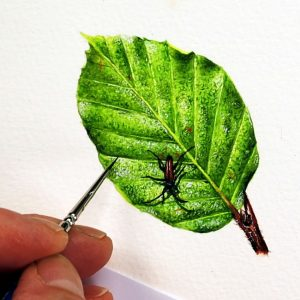 Paul Hopkinson painting a realistic watercolor leaf