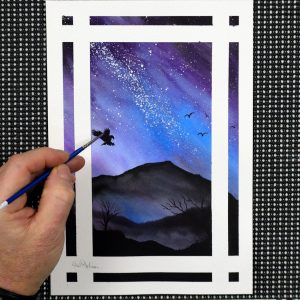 Paul Hopkinson painting a starry night sky in watercolour
