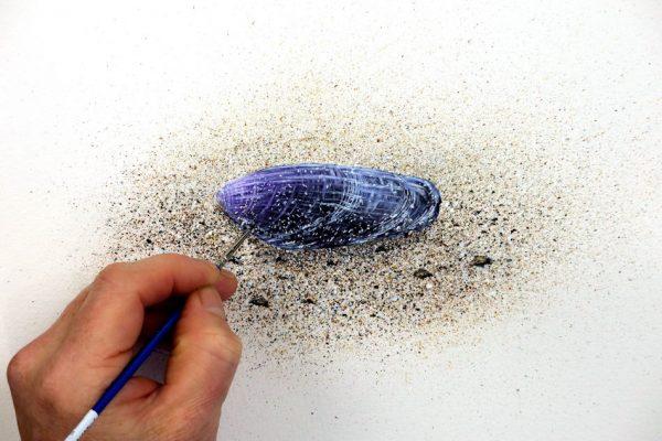 Paul Hopkinson painting a watercolour beach shell